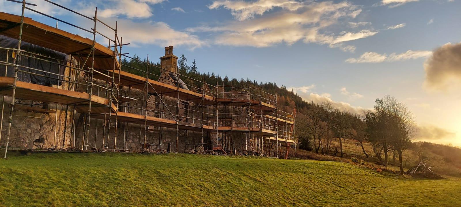 Boleskine House with scaffolding at sunset